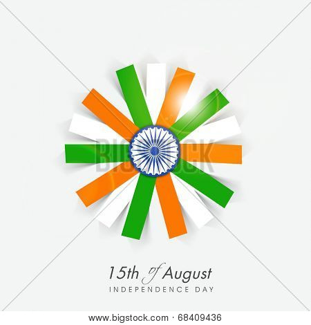 Beautiful flower design in Indian national flag colors with ashoka wheel on grey background  for 15th of August, Independence Day celebrations.