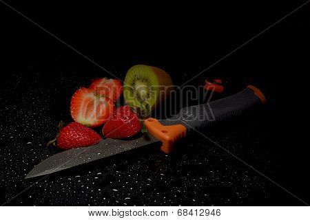 Fresh Fruits With Water Drops On Them And Knife