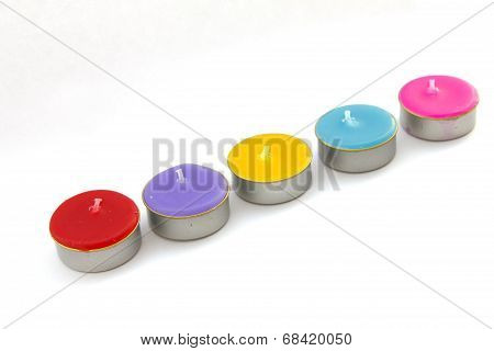 Colorful Short Candles Without Flame. Isolated Over White Background