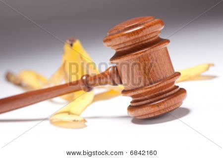 Gavel And Banana Peel On Gradated Background