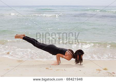 Woman balancing on her arms