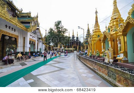 Rangoon, Myanmar - October 11, 2013: Buddhist People Visit Shwedagon Pagoda In Rangoon.