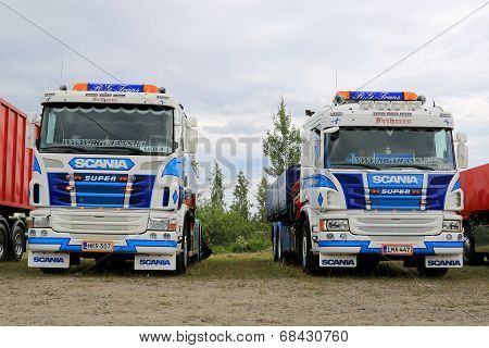 Two Colorful Scania Tipper Trucks In A Show