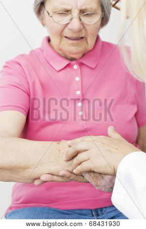 Dermatologist Looking At Patient Skin