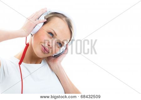 Pretty, young woman listening to her favorite music on hi-fi headphones, dancing, enjoying the tune, having a moment for herself