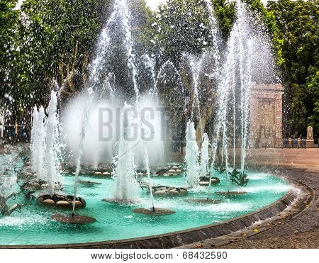 Illuminated water features in front of Palais des Congress in Perpignan, France