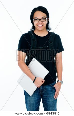 Happy college student holding laptop