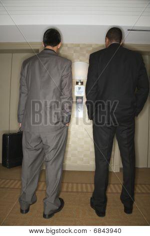 Businessmen Waiting For Elevator