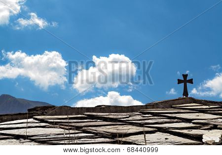 Christian Cross On A Roof
