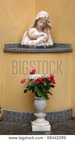 PORTOFERRAIO, ELBA, ITALY - MAY 03, 2014: The statue of Madonna with the Child in front of the Church of the Holy Sacrament in Portoferraio, Island of Elba, Tuscany, Italy on May 03, 2014