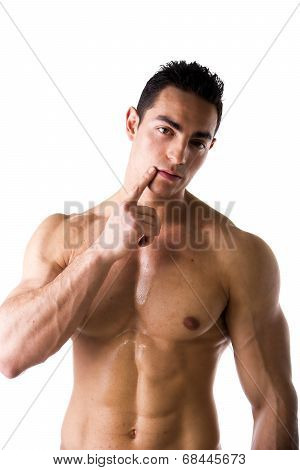 Muscular Shirtless Young Man Touching Lips With Finger