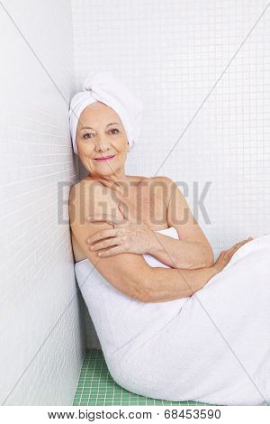 Senior woman relaxing in health resort treatment in a spa