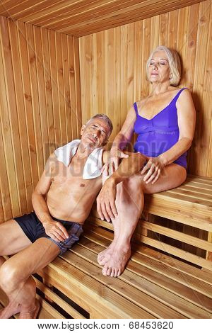 Senior couple relaxing in hotel sauna in their holidays