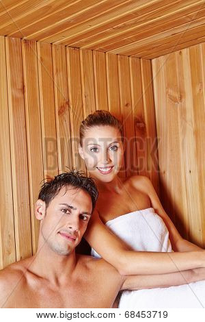 Attractive couple in holiday sweating in a sauna in a spa