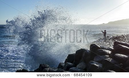 Fisherman silhouette and wave
