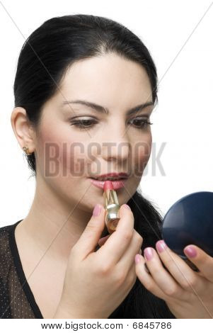 Brunette Female Applying Lipstick In Mirror