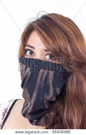 beautiful girl covering her face with a black scarf