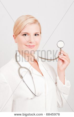 Young female doctor with medical stethoscope