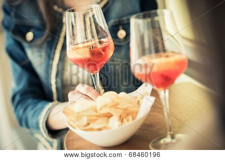 Young women enjoying their aperitif