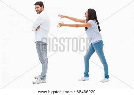 Brunette reaching desperately for man on white background