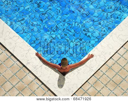 woman in the corner of the water pool