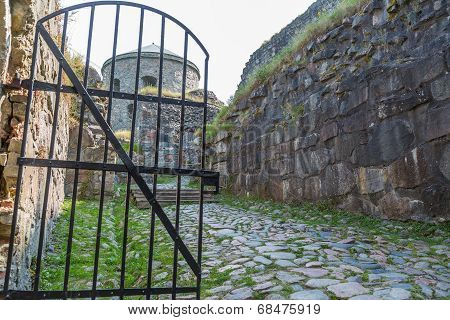 Fortress Ruin And A Iron Gate