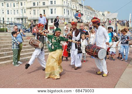 ST.LEONARDS-ON-SEA, ENGLAND - JULY 12, 2014: The Musifar Gypsies of Rajasthan, Indian music group, lead the parade on the seafront at the annual St.Leonards Festival. The event was first held in 2006.