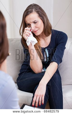 Depressed Woman Crying During Therapy