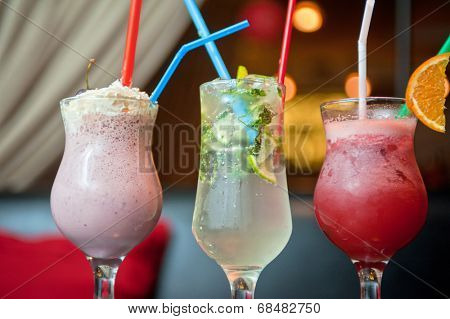 Set of three healthy nonalcoholic cocktails berries and classic mojito