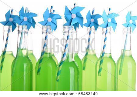 Bottles of drink with straw isolated on white