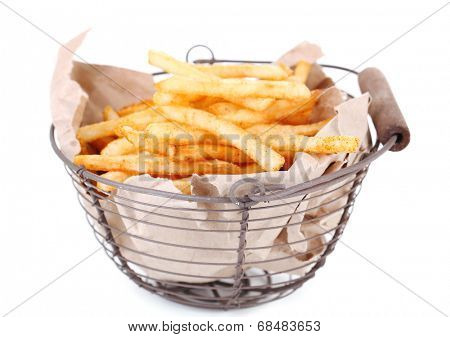 Tasty french fries in metal basket, isolated on white