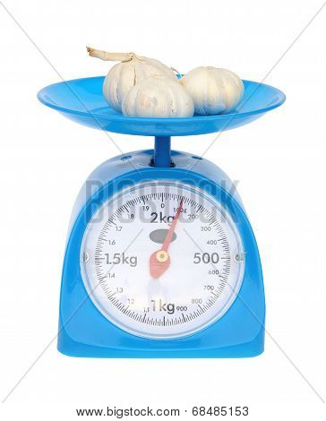 Kitchen Scales And Garlic Isolated On White Background