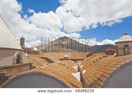 El Cerro Rico Mountain Raising Over The Colonial Roofs Of Potosi, Bolivia