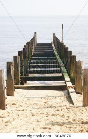 Groyne Leading Into The Sea