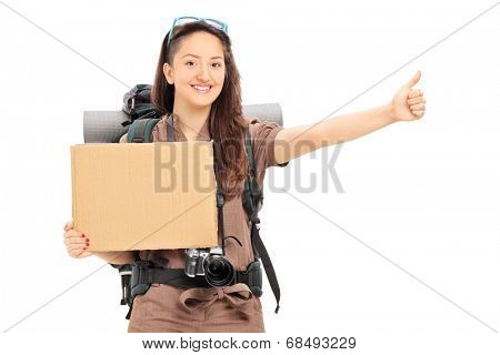 Female hitchhiker holding a blank banner isolated on white background
