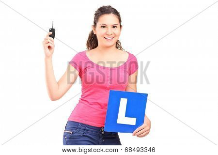 Girl holding an l sign and a car key isolated on white background