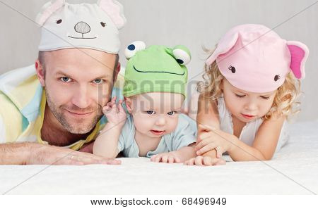 Happy Dad With Kids In Funny Hats