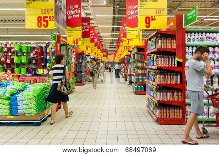 People Shopping In Supermarket Store