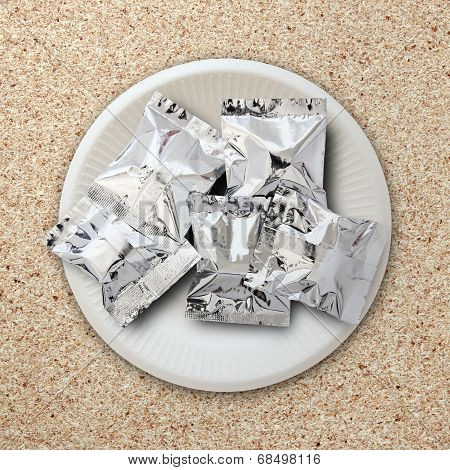 Foil Package On White Plate