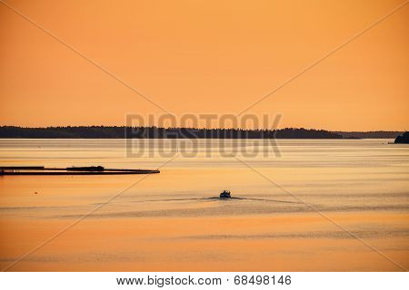 Boat Going Out In The Arhipelago In The Sunset