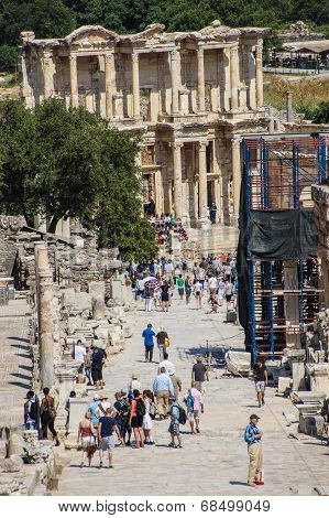 Tourists Walk To The Library Of Celsus