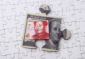 stock photo of yuan  - Dollar and Yuan on Puzzle - JPG
