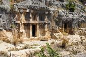 foto of rock carving  - Lycian rock cut tombs carved into the hillside of Myra Turkey - JPG
