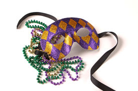 stock photo of mardi gras mask  - Purple and Gold Venetian mask with Mardi Gras Beads on White with Soft Shadow - JPG