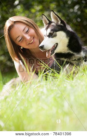 Young Woman With Her Husky Dog