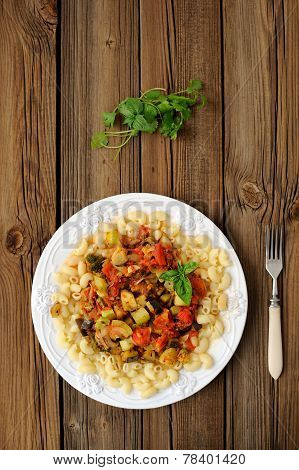 Pasta With Tomato Sause On Wooden Background