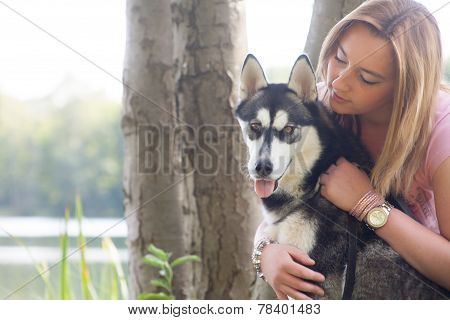 Young Girl Loves Her Husky Dog