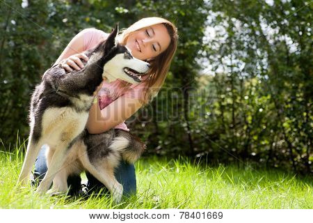 Girl And Her Husky