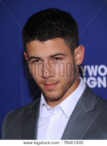 LOS ANGELES - AUG 14:  Nick Jonas arrives to the HFPA Annual Installation Dinner 2014 on August 14, 2014 in Beverly Hills, CA