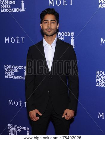 LOS ANGELES - AUG 14:  Manish Dayal arrives to the HFPA Annual Installation Dinner 2014 on August 14, 2014 in Beverly Hills, CA